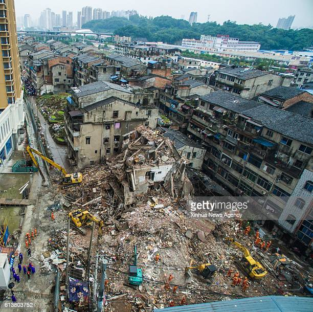 WENZHOU Oct 10 2016 Rescuers search for survivors at the accident site after four residential houses collapsed in Lucheng industrial district in...