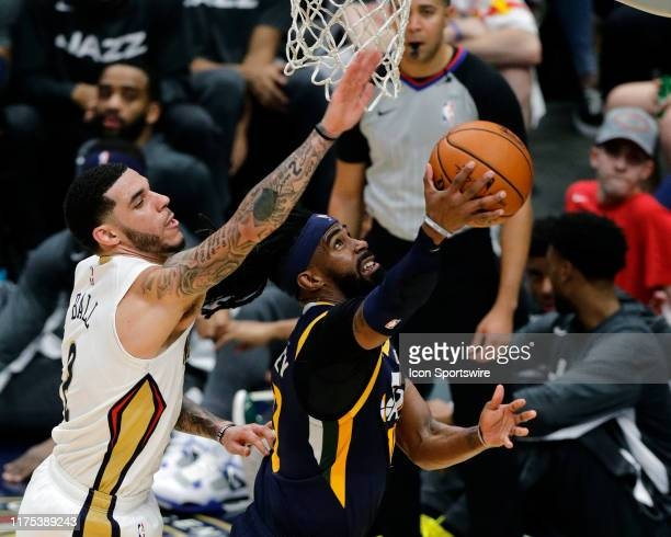 Utah Jazz guard Mike Conley drives to the basket against New Orleans Pelicans guard Lonzo Ball during a NBA preseason game between the New Orleans...