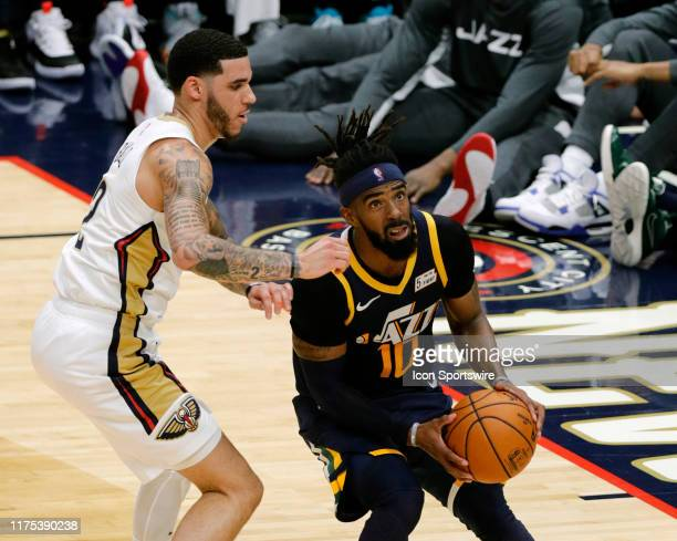 Utah Jazz guard Mike Conley drives to the basket agaisnt New Orleans Pelicans guard Lonzo Ball during a NBA preseason game between the New Orleans...
