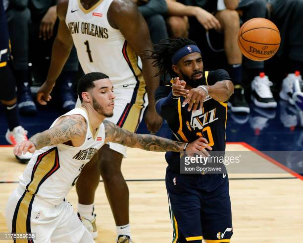 Utah Jazz guard Mike Conley passes against New Orleans Pelicans guard Lonzo Ball during a NBA preseason game between the New Orleans Pelicans and the...