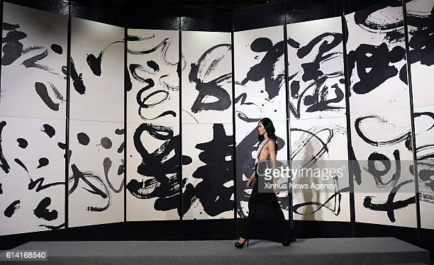 TAIPEI Oct 12 2016 A model presents a creation with Chinese calligraphy elements during a fashion show in Taipei southeast China's Taiwan Oct 12 2016