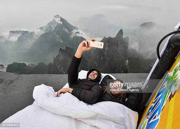 ZHANGJIAJIE Oct 13 2016 Graham Dickinson and Rob Heron of Canada pose for a selfie while lying on the jumping platform before the qualification of...