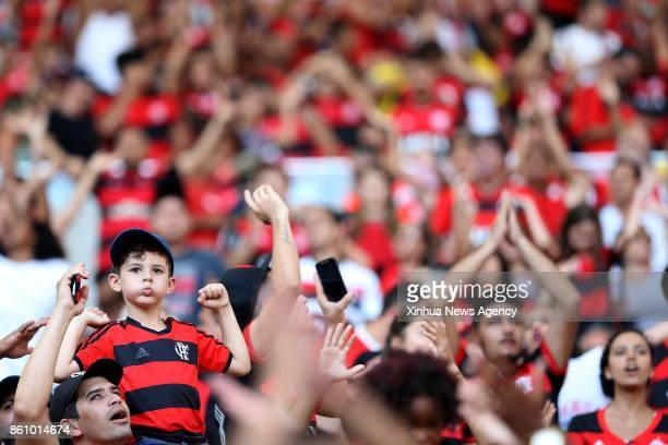 JANEIRO Oct 13 2017 A young supporter of Flamengo cheers ahead of the 2017 Brazilian Serie A 27th round match between Fluminense and Flamengo at the...
