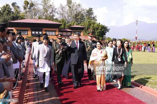 KATHMANDU Oct 13 2019 Nepali President Bidya Devi Bhandari hosts a grand farewell ceremony for Chinese President Xi Jinping at the airport in...