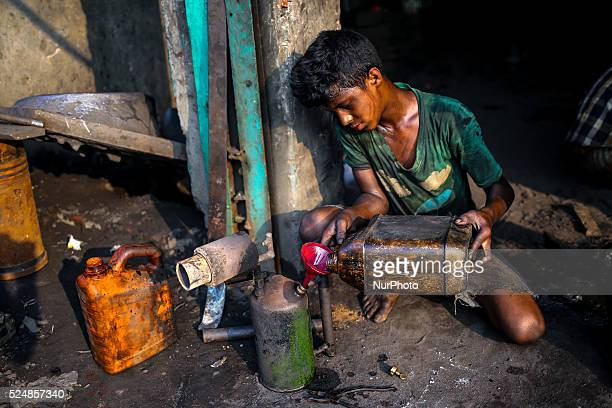 Oct 14 2015 Dhaka Bangladesh Ship building industry in Bangladesh spreading rapidly where workers from all ages work together The working condition...