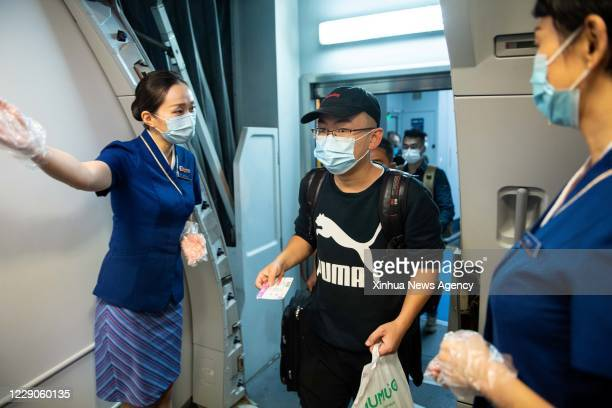 Oct. 14, 2020 -- Passengers of the flight CZ6043 board the plane at the Changsha Huanghua International Airport in Changsha, capital of central...