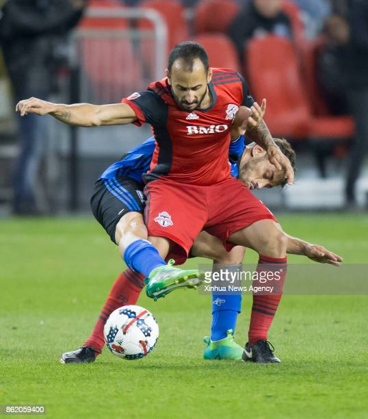 TORONTO Oct 15 2017 Victor Vazquez of Toronto FC vies with Hernan Bernardello of Montreal Impact during the 2017 Major League Soccer match between...