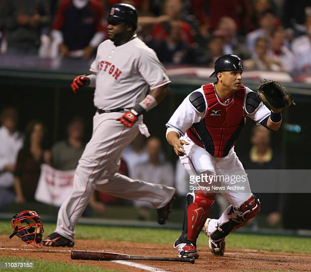 Oct 16 2007 Cleveland OH USA The Cleveland Indians catcher VICTOR MARTINEZ waits for the throw while Boston Red Sox DAVID ORTIZ scores on Manny...