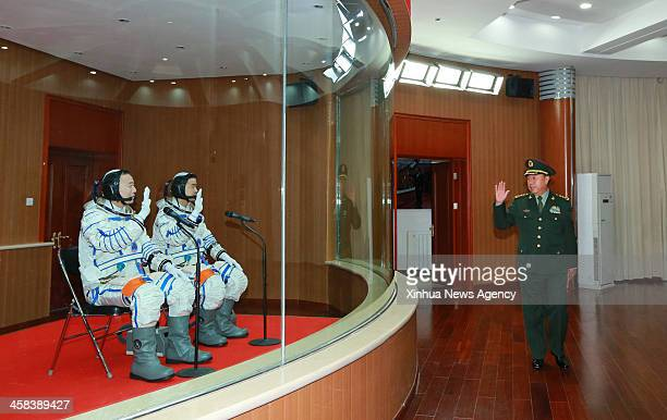 JIUQUAN Oct 17 2016 Fan Changlong vice chairman of the Central Military Commission meets with astronauts Jing Haipeng and Chen Dong at the apartment...