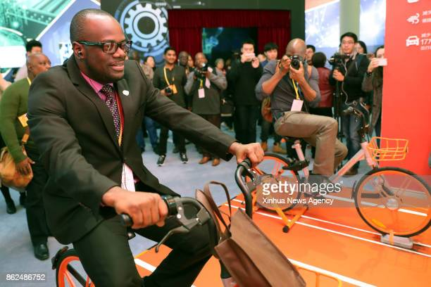 BEIJING Oct 17 2017 A journalist experiences a shared bike at Beijing Exhibition Center in Beijing capital of China Oct 16 2017 Journalists from a...