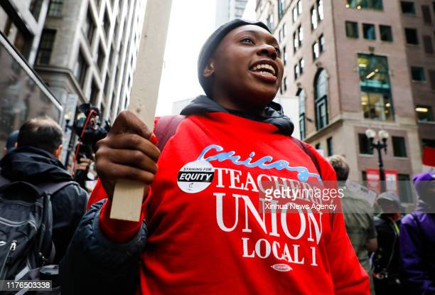 Oct. 17, 2019 -- A teacher takes part in the Chicago Teachers' Union strike rally in downtown Chicago, the United States, on Oct. 17, 2019. Thousands...