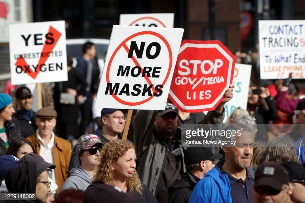 Oct. 17, 2020 -- Protesters hold signs during an anti-restriction rally in Vancouver, British Columbia, Canada, on Oct. 17, 2020. Thousands of...