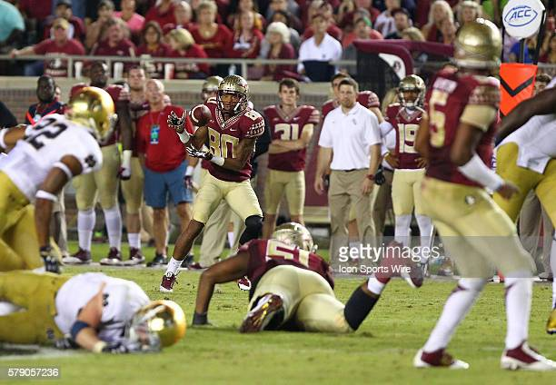Florida State's Rashad Greene catches a pass from quarterback Jameis Winston in the game between the Notre Dame Fighting Irish and the Florida State...