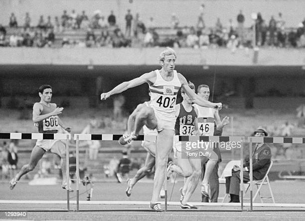 David Hemery of Great Britain leads the field during the 400 metres Hurdles event at the 1968 Olympic Games in Mexico City. Hemery won the gold...
