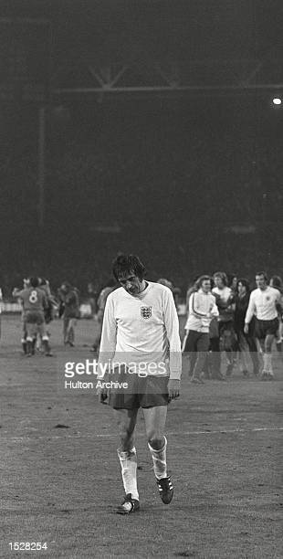 World Cup Qualifier England v Poland Wembley Norman Hunter shoulders and head down in disappointment trudges of the Wembley pitch after England's...