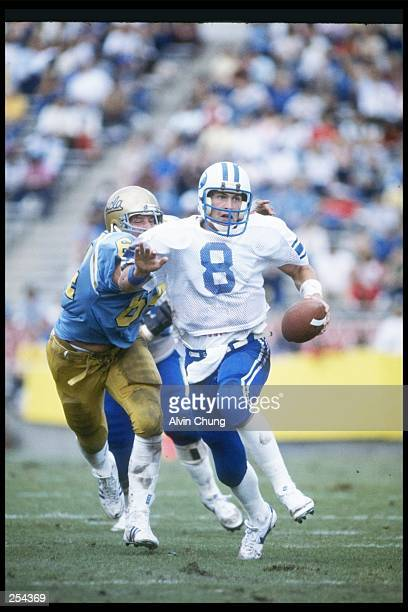Quarterback Steve Young of the Brigham Young BYU Cougars runs down the field during a game against the UCLA Bruins at the Rose Bowl in Pasadena...