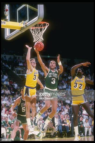 Guard Dennis Johnson of the Boston Celtics goes up for the ball during a game against the Los Angeles Lakers at the Great Western Forum in Inglewood...