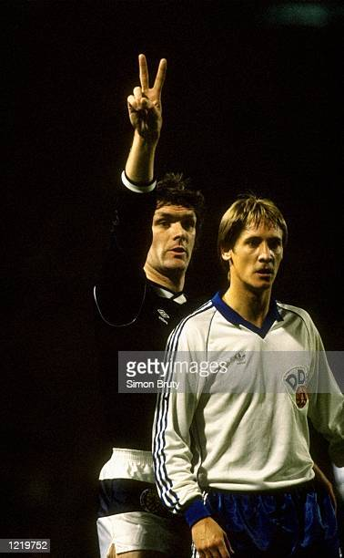 Roy Aitken of Scotland points the way for his teammates during the international match against East Germany played at Hampden Park in Glasgow...