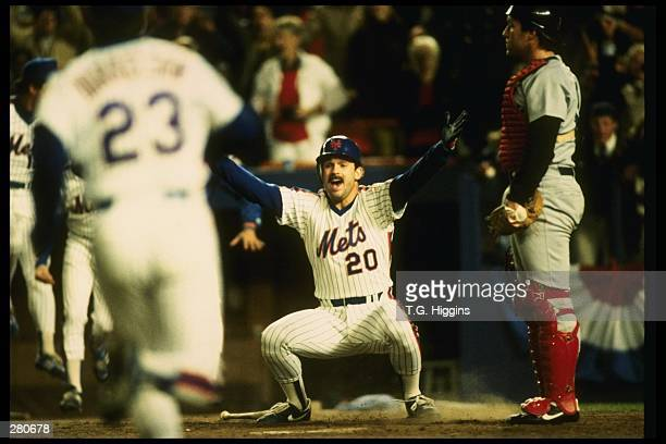 Howard Johnson of the New York Mets celebrates after scoring at home plate during the Mets 85 win over the Boston Red Sox in game 7 of the World...