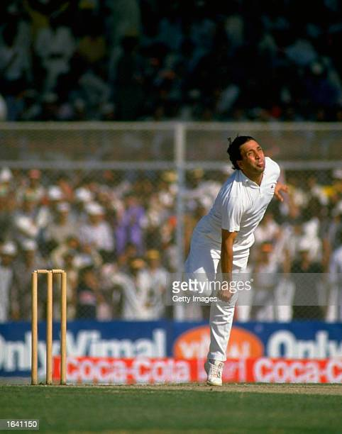 Abdul Qadir of Pakistan bowls during the World Cup Match against the West Indies at the National Stadium in Karachi Pakistan Mandatory Credit...