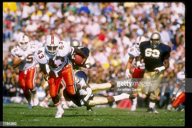 Cleveland Gary of the Miami Hurricanes runs down the field during a game against the Notre Dame Fighting Irish at Notre Dame Stadium in South Bend,...