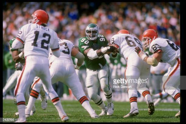 Defensive tackle Reggie White of the Philadelphia Eagles runs toward quarterback Don Strock of the Cleveland Browns during a game at Cleveland...