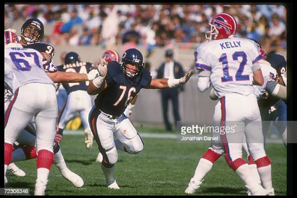 Defensive tackle Steve McMichael of the Chicago Bears goes after Bullalo Bills quarterback Jim Kelly during a game at Rich Stadium in Orchard Park...