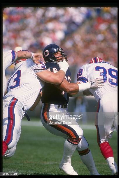 Defensive tackle Steve McMichael of the Chicago Bears works against the Buffalo Bills during a game at Rich Stadium in Orchard Park New York The...