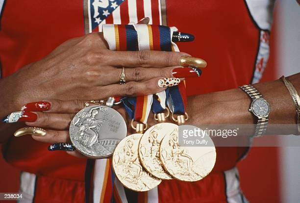 Florence GriffithJoyner of the USA displays her three gold medals and a silver medal that she won at the 1988 Summer Olympics in Seoul Korea...
