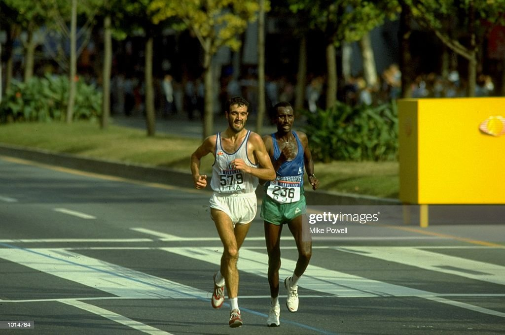 Gelindo Bordin and Ahmed Saleh : News Photo