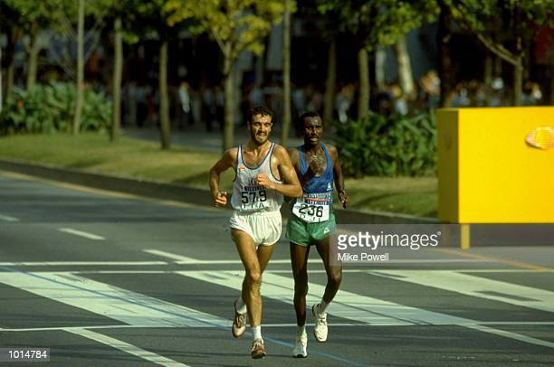 Gelindo Bordin of Italy and Ahmed Saleh of Djibouti in action during the Mens Marathon event of the 1988 Olympic Games in Seoul South Korea Bordin...