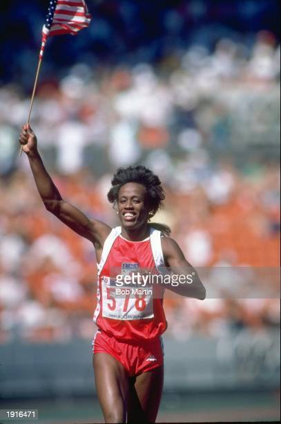 Jackie JoynerKersee of the USA celebrates after winning the Long Jump event at the 1988 Olympic Games in Seoul South Korea Mandatory Credit Bob...