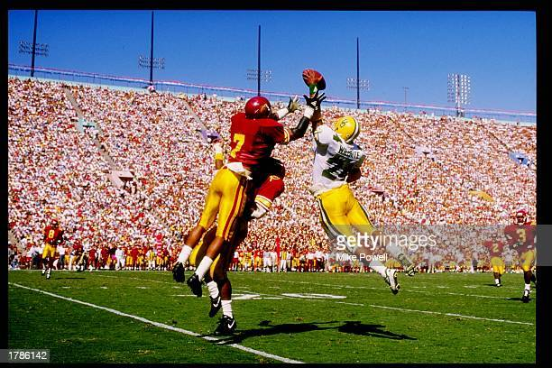 Mark Carrier of the USC Trojans goes up for an interception during the Trojans 42-14 victory over the Oregon Ducks at the Los Angeles Memorial...