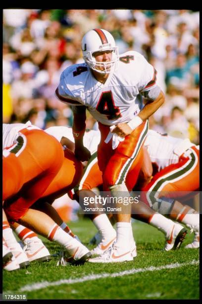 Quarterback Steve Walsh of the Miami Hurricanes calls the cadence during a game against the Notre Dame Fighting Irish at Notre Dame Stadium in South...