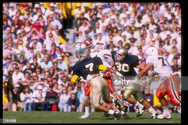 Quarterback Steve Walsh of the Miami Hurricanes drops back to pass during a game against the Notre Dame Fighting Irish at Notre Dame Stadium in South...