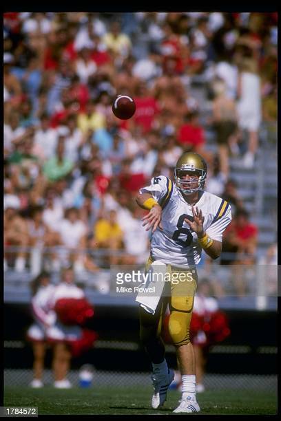 Quarterback Troy Aikman of the UCLA Bruins passes the ball during a game against the Arizona Wildcats at Arizona Stadium in Tucson Arizona UCLA won...