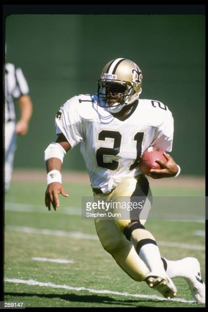 Running back Dalton Hilliard of the New Orleans Saints moves the ball during a game against the San Diego Chargers at Jack Murphy Stadium in San...