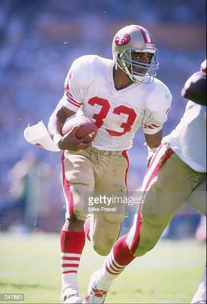 Running back Roger Craig of the San Francisco 49ers runs down the field during a game against the Los Angeles Rams at Anaheim Stadium in Anaheim,...