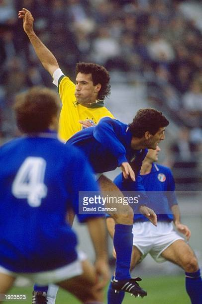 Careca of Brazil clashes with an Italian player during a Friendly match in Italy Brazil won the match 10 Mandatory Credit David Cannon/Allsport