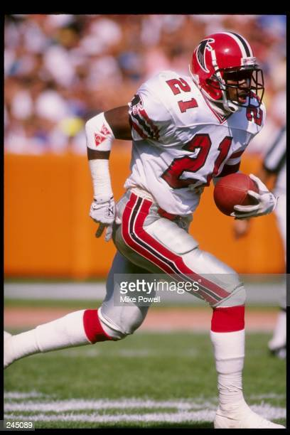 Defensive back Deion Sanders of the Atlanta Falcons in action with the ball during a game against the Los Angeles Rams at Anaheim Stadium in Anaheim...