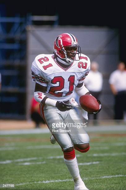 Defensive back Deion Sanders of the Atlanta Falcons runs with the ball during a game against the New England Patriots at Fulton County Stadium in...