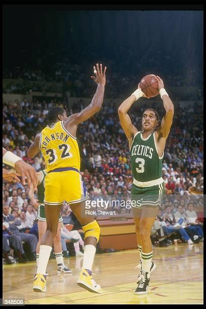 Guard Dennis Johnson of the Boston Celtics looks to pass the ball during a game against the Los Angeles Lakers at the Great Western Forum in...