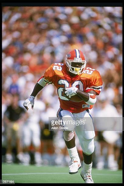Running back Emmitt Smith of the Florida Gators runs down the field during a game against the Vanderbilt Commadores at Florida Field in Gainesville,...