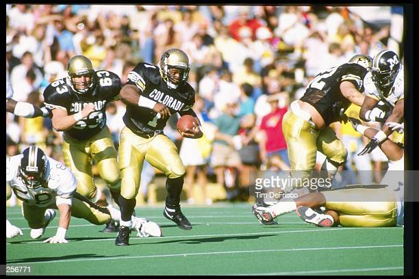 Running back Eric Bieniemy of the Colorado Buffaloes runs down the field during a game against the Missouri Tigers at Folsom Field in Boulder...