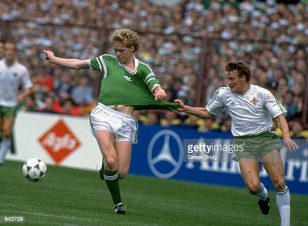 Steve Staunton of the Republic of Ireland has his shirt tugged by Danny Wilson of Northern Ireland during the World Cup qualifying match in Dublin,...