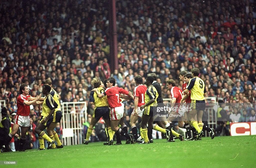 Manchester United and Arsenal players fight on the pitch during the Barclays League Division One match at Old Trafford in Manchester, England. Arsenal won the match 1-0. \ Mandatory Credit: Russell Cheyne/Allsport