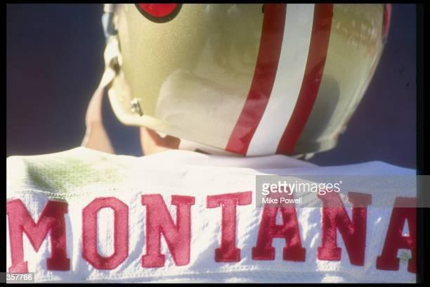 Quarterback Joe Montana of the San Francisco 49ers looks on during a game against the Atlanta Falcons at the Fulton County Stadium in Atlanta Georgia...