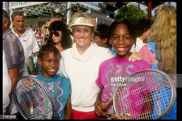 Tracy Austin stands with sisters Venus Williams and Serena Williams at the Nancy Reagan Tennis tournament