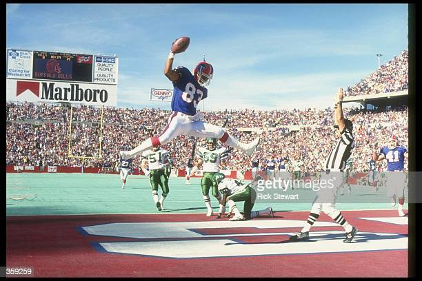 Wide receiver Andre Reed of the Buffalo Bills scores a touchdown during a game against the New York Jets at Rich Stadium in Orchard Park New York The...