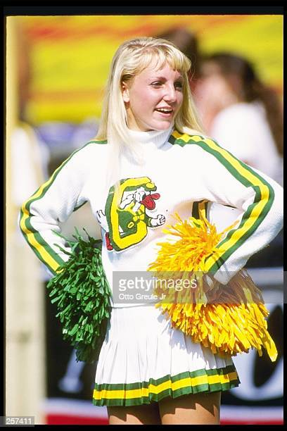 A cheerleader for the Oregon Ducks does her routine during a game against the California Bears at Memorial Stadium in Berkley California California...